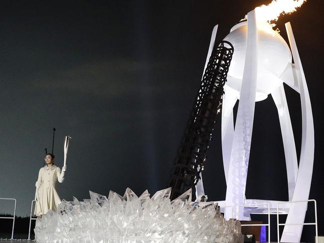 South Korean Olympic figure skating champion Yuna Kim lights the Olympic flame during the opening ceremony of the 2018 Winter Olympics in Pyeongchang, South Korea. Picture: AP