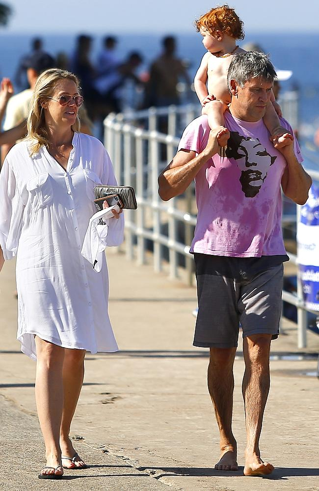 Happy family ... Leila McKinnon and David Gyngell with son Ted at Bondi Beach. Picture: Bradley Hunter
