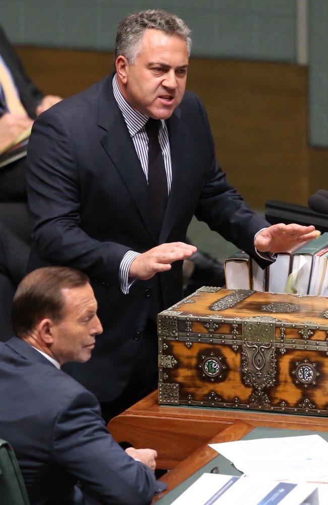 University changes should be shredded ... Treasurer Joe Hockey defends his Budget in Federal Parliament with Prime Minister Tony Abbott looking on.