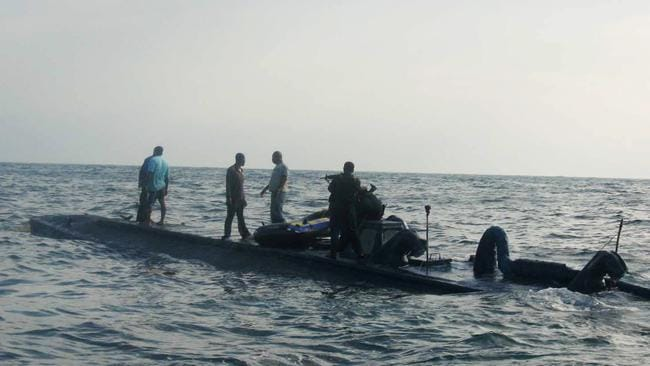 Naval officers arrest crew members of a homemade submarine used to transport cocaine, intercepted some 170km into the Pacific Ocean from the seaport of Buenaventura, in southern Colombia. Picture: AP
