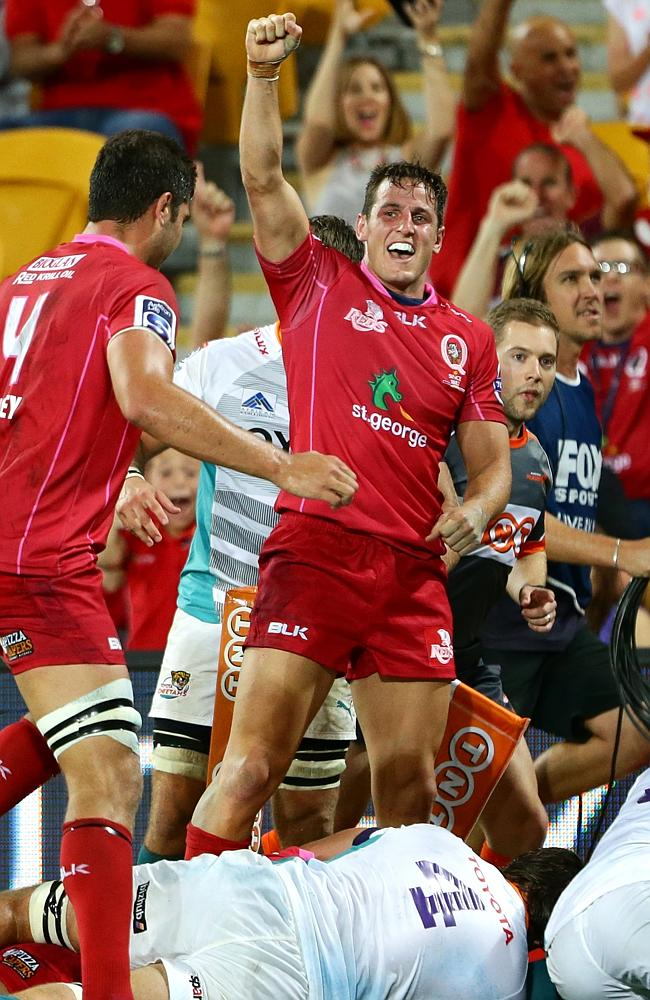 Mike Harris celebrates a Reds try against the Cheetahs. Picture: Darren England