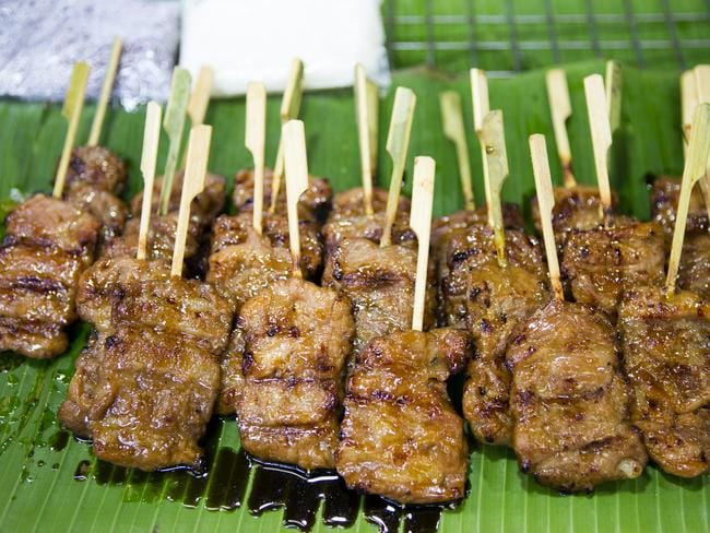 Thai grilled pork satay called Moo Yang is a popular street food snack.