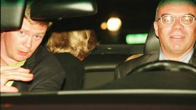 The head of the Princess of Wales, in the rear seat, her bodyguard Trevor Rees-Jones, (L) and driver Henri Paul are seen shortly before the car crash that killed Diana, her companion Dodi Al Fayed and the driver in the Pont de l'Alma Tunnel in Paris. The image was presented at the British inquest into the deaths of Diana and Dodi.