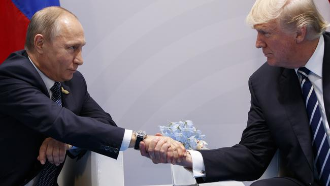 Was that a look of mutual appreciation back at the G20 in July? Or were they just comparing hand sizes? Picture: Evan Vucci