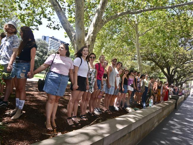 People gather for a Women's March demonstration in Hyde Park, Sydney. Picture: AAP