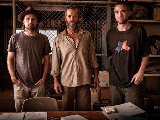 At home ... Robert Pattinson, right, with  <i>The Rover </i>director David Michod and co-star Guy Pearce.