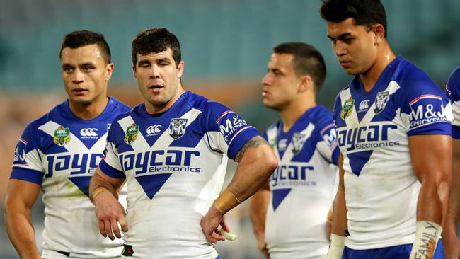 Bulldogs players looking dejected after a Cowboys try.