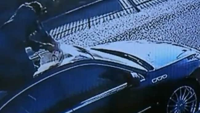 CCTV footage of the woman destroying the car. Source: KTLA