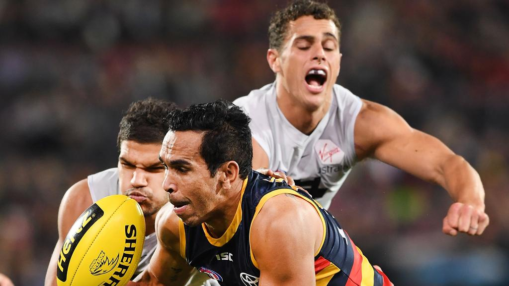 Eddie Betts of the Adelaide Crows under pressure from Sam Petrevski-Seton  of the Blues