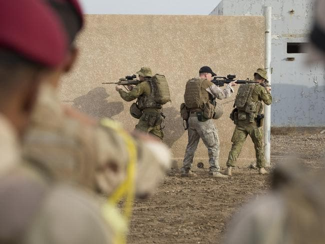 Australian and New Zealand army trainers conduct a demonstration of a squad formation in Iraq. Picture: Supplied
