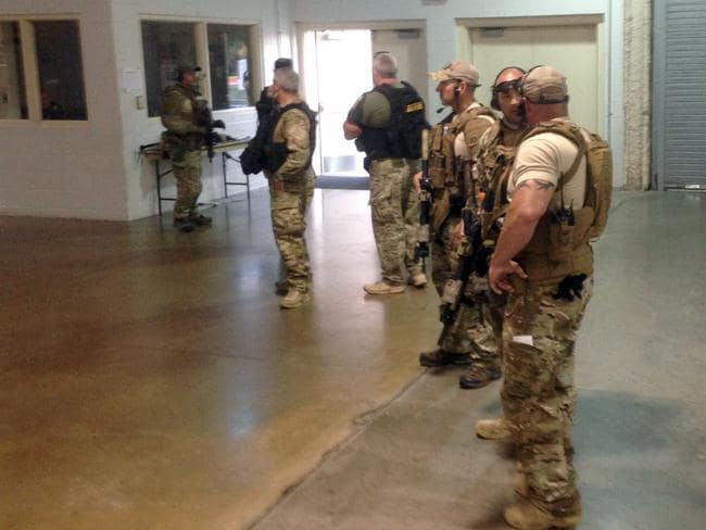 Armed ... Police stand inside the Curtis Culwell Center. Picture: Nomaan Merchant/AP