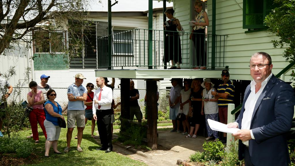 Place Estate Agents' Peter Burgin prepares to call the auction of 16 Macaulay St, Coorparoo. Picture: Mark Calleja