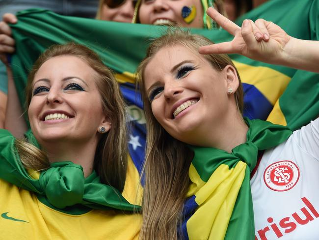 Brazil fans cheer prior to the Group A football match between Cameroon and Brazil at the Mane Garrincha National Stadium in Brasilia.