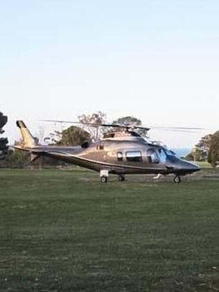 Choppergate ... Bronwyn Bishop landing in a helicopter at a Geelong Golf Club in November 2014.