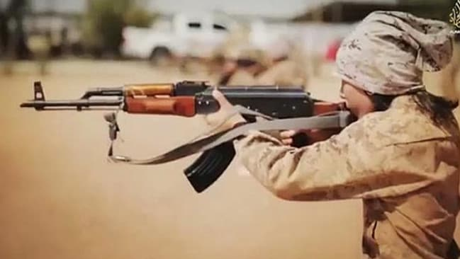 Opening fire ... an Islamic State child soldiers engages in target practice. Source: Supplied.