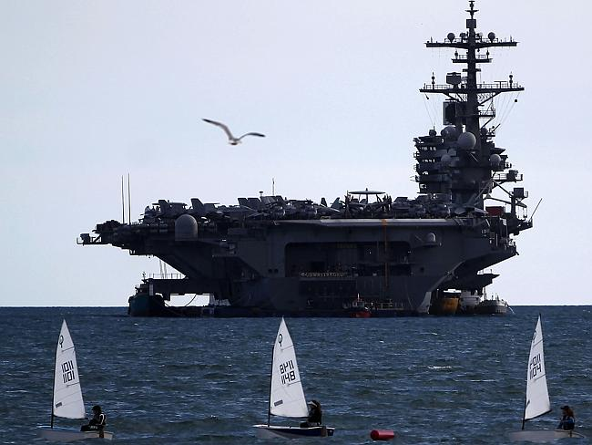 Power projection ... the aircraft carrier USS George H W Bush moored outside Piraeus port southwest of Athens, on March 5. Picture: Angelos Tzortzinis