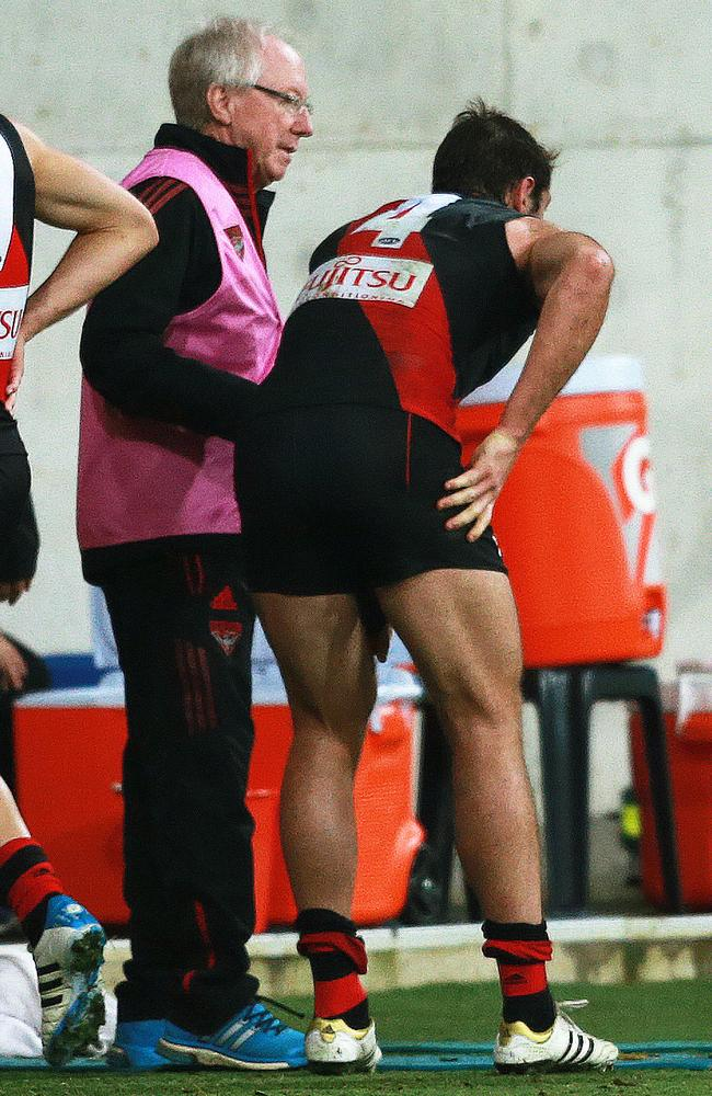 Bombers skipper Jobe Watson reaches for his injured thigh. Picture:
