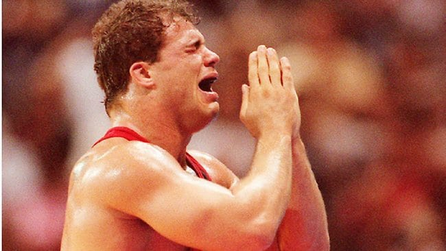Kurt Angle reacts after winning gold in the heavyweight wrestling division at the 1996 Atlanta Olympics.
