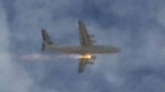 Supplied pictures of a plane engine on fire over Perth Airport.