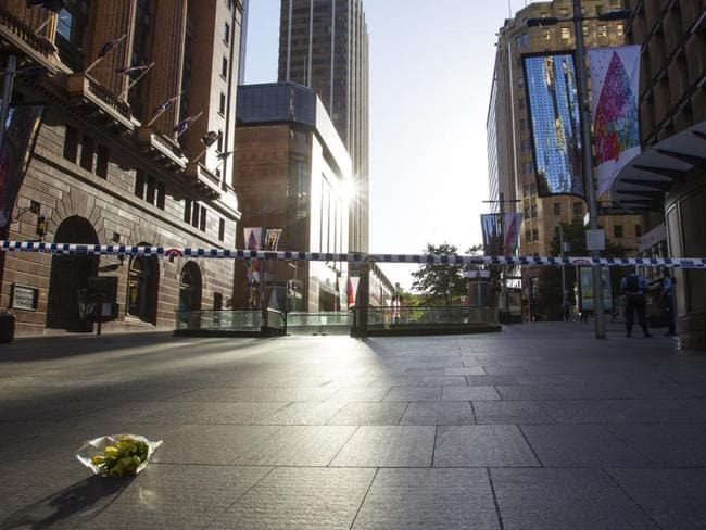 Flowers left at Martin Place. Picture by: Kate Dwek / Splash News