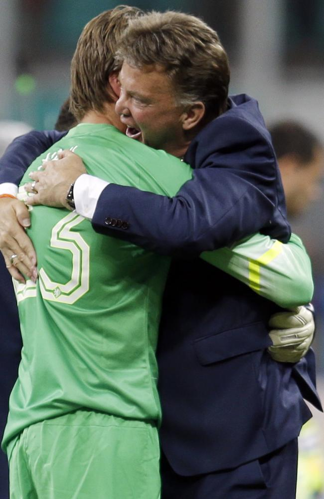 Netherlands' head coach Louis van Gaal hugs goalkeeper Tim Krul after the Netherlands defeated Costa Rica 4-3 in a penalty shootout in their World Cup quarter-final.