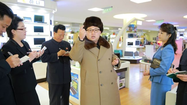 This undated picture released from North Korea's official Korean Central News Agency (KCNA) on March 28, 2016 shows the couple inspecting the newly built Mirae Shop in Pyongyang. Photo: AFP PHOTO/KCNA VIA KNS