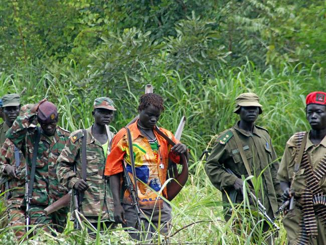 Members of Uganda's LRA are seen in 2006 as their leader Joseph Kony meets with a delegation of Ugandan officials, lawmakers and representatives from non-governmental organisations, in the Democratic Republic of Congo near the Sudanese border. Picture: AP