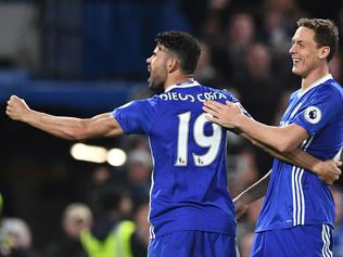 Chelsea's Brazilian-born Spanish striker Diego Costa (L) celebrates with Chelsea's Serbian midfielder Nemanja Matic after scoring their third goal during the English Premier League football match between Chelsea and Southampton at Stamford Bridge in London on April 25, 2017. / AFP PHOTO / Justin TALLIS / RESTRICTED TO EDITORIAL USE. No use with unauthorized audio, video, data, fixture lists, club/league logos or 'live' services. Online in-match use limited to 75 images, no video emulation. No use in betting, games or single club/league/player publications. /