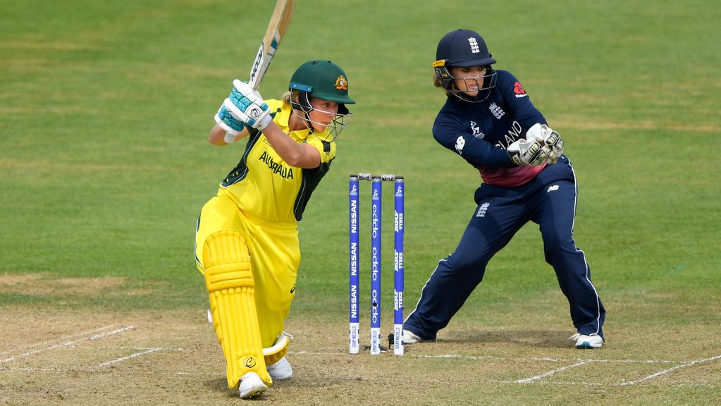 England keeper Sarah Taylor looks on as Australia's Beth Mooney hits out during the ICC Women's World Cup. Picture: Stu Forster/Getty Images