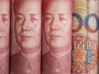 This photo illustration taken on January 6, 2017 shows Chinese 100 yuan notes in Beijing. China just raised the exchange rate for the yuan against the US dollar by 0.92 percent from the previous day, the biggest one-day increase in more than 11 years. / AFP PHOTO / FRED DUFOUR