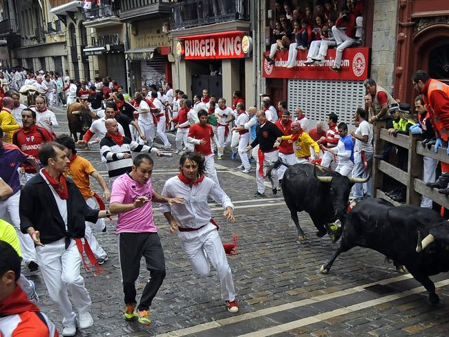 Panic ... Participants flee during the third bull-run of the San Fermin Festival in Pamplona. Picture: AFP