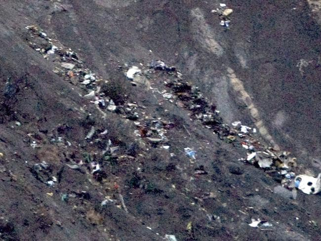 Debris of the Germanwings passenger jet is scattered on the mountain side near Seyne less Alpes, French Alps. Pic: Claude Paris