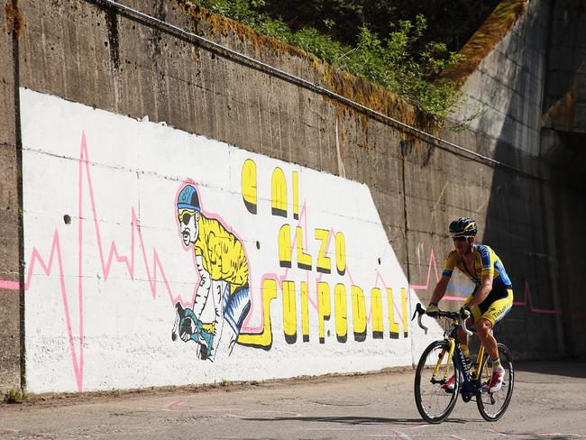 Michael Rogers of Australia and Tinkoff-Saxo rides past a Marco Pantani mural at this year's Giro d'Italia.