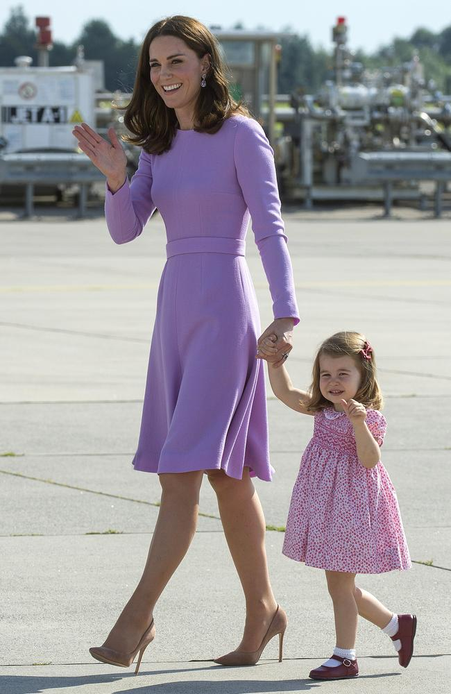 Ladies in purple. Kate's Emilia Wickstead frock was of a similar sartorial tone to her daughter's floral-printed dress. Picture: AP