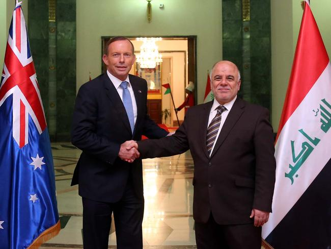 Shaking hands ... Iraqi Prime Minister Haider al-Abadi greeting his Australian counterpart Tony Abbott in Baghdad. Picture: AFP
