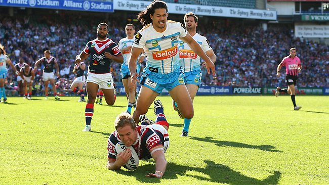 Mitchell Aubusson of the Roosters scores a try.