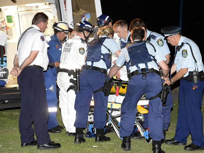 Police and paramedics stabilise the man. Picture: Gordon Mccomiskie