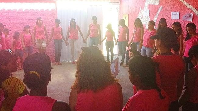 "Girls take part in therapy called the ""conversation circle"" at the Pink House. Not all the girls in this photograph were former prostitutes. Picture: Matt Roper."