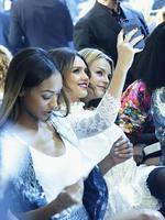 PARIS FASHION WEEK 2014: Jessica Alba takes a selfie at the H&M show. Picture: Getty