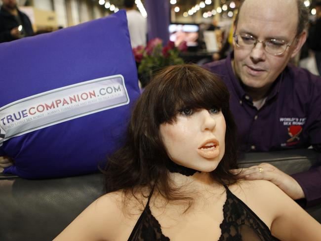 Douglas Hines, founder of the True Companion company, poses with a life-size rubber doll named Roxxxy during the Adult Entertainment Expo in Las Vegas, Nevada.