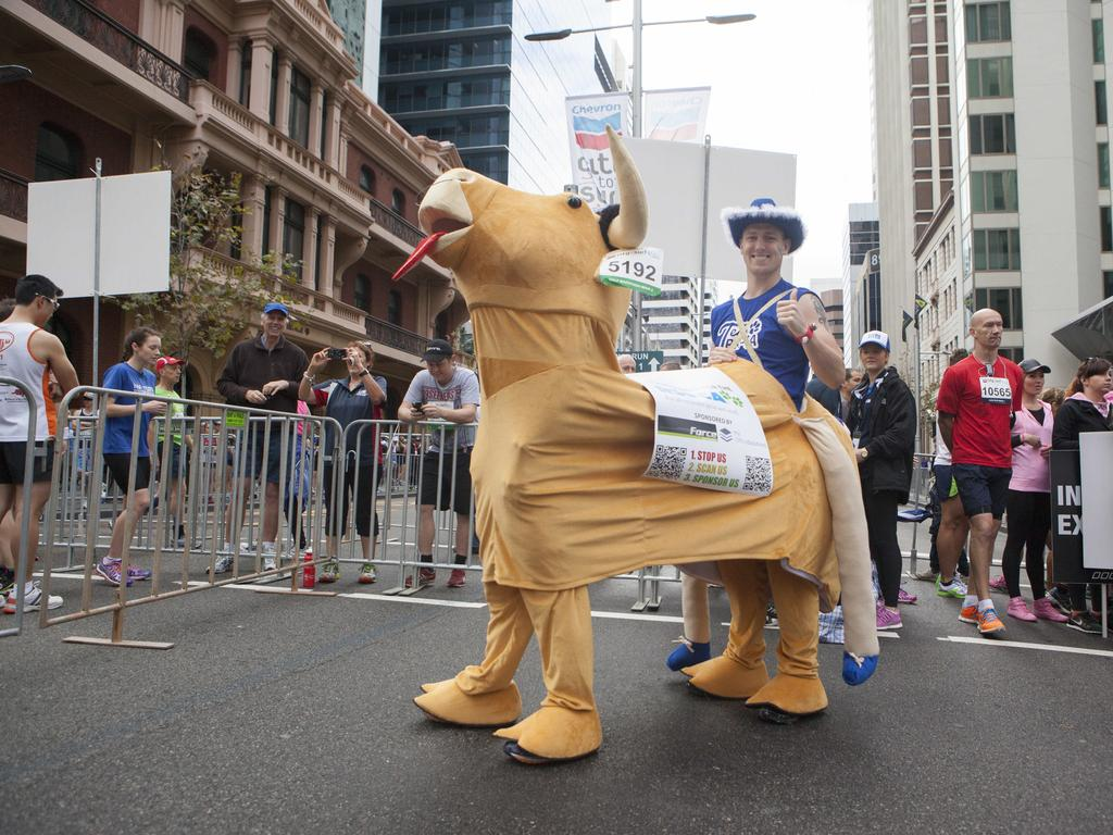 All the action, effort, fun, competitiveness and colourful characters at the 2014 Chevron City to Surf for Activ start line. Picture: Jordan Shields
