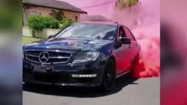 Thick plumes of pink smoke billowed from their car. Picture: 9 News