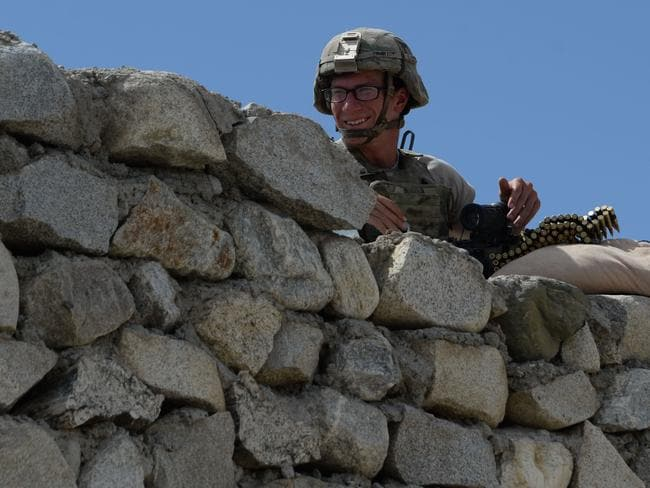 A US soldier stands guard near the site of a US bombing during an operation against Islamic State (IS) militants in the Achin district of Nangarhar province. Picture: AFP