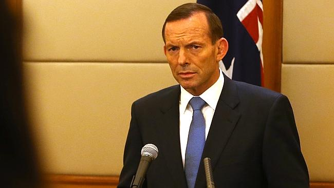 Growing caution... Prime Minister Tony Abbott answers questions from Chinese media.