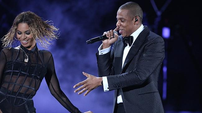 """Beyonce, left, and Jay-Z perform """"Drunk in Love"""" at the 56th annual Grammy Awards. (Photo by Matt Sayles/Invision/AP)"""