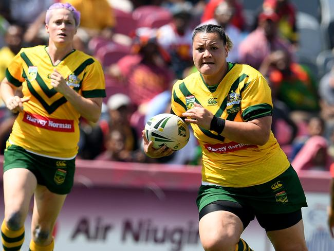 Australian Jillaroos rugby league player Chelsea Baker on the run against PNG.