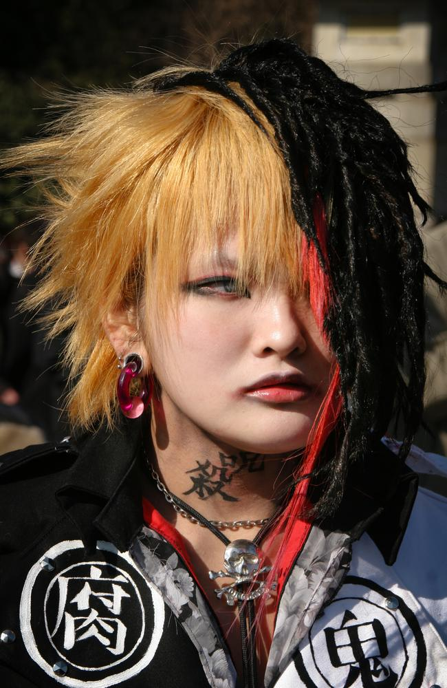 A young Japanese woman dresses up in cosplay as Ruki from the Japanese visual kei band Gazette.