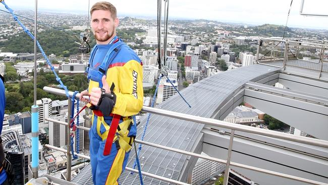Newly signed member of the New Zealand Warriors Sam Tomkins poses for a photo before his jump off the Auckland Skytower.