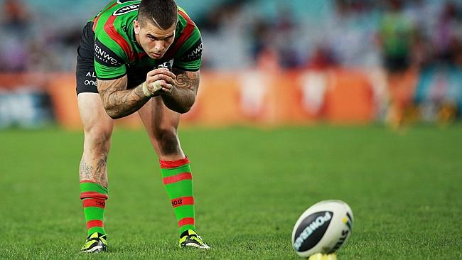 Adam Reynolds lines up a kick during a clash between the Rabbitohs and the Storm.