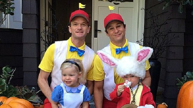 Neil Patrick Harris (left) and fiance David Burtka along with twins Harper and Gideon fell down the rabbit hole this Halloween.